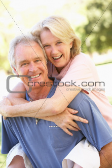 Portrait Of Romantic Senior Couple In Park