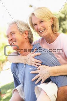 Portrait Of Romantic Senior Couple In Park