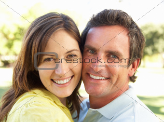 Portrait Of Romantic Couple In Park