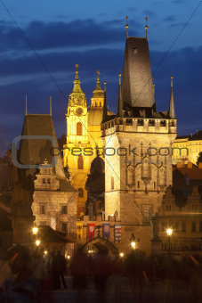 czech republic prague - charles bridge tower and st. nicolau church at dusk