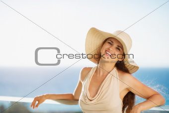 Happy woman on vacation standing on balcony