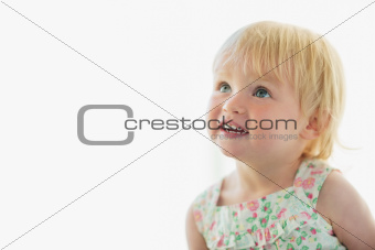 Portrait of lovely baby looking on copy space