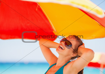 Happy woman enjoying vacation on beach