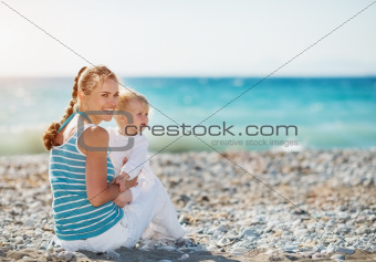 Happy mother and baby looking on copy space