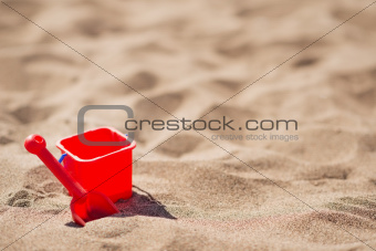 Baby bucket and shovel on the sandy beach