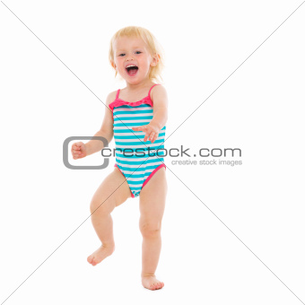 Portrait of cheerful baby in swimsuit