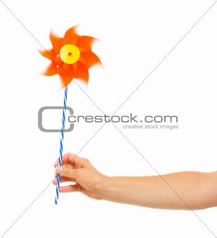 Closeup on hand holding pinwheel