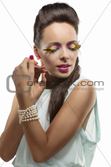 pretty brunette with feathered makeup and closed eyes