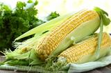 fresh corn vegetable   on wooden table