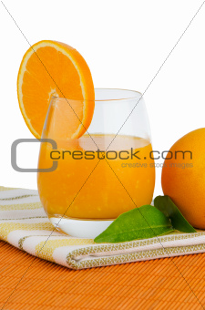 Cup of orange juice and fresh orange