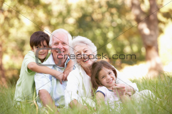 Grandparents In Park With Grandchildren