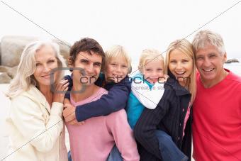 Close Up Of Three Generation Family On Winter Beach