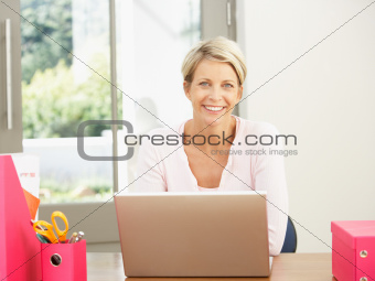 Woman Using Laptop At Home