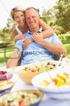 Couple Enjoying Meal In Garden