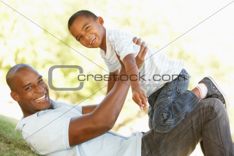 Portrait of Happy Father and Son In Park