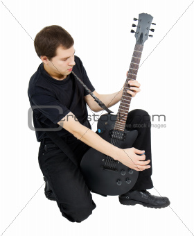 young singer, dressed in black with an electric guitar