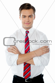 Smart young perfessional posing with folded arms