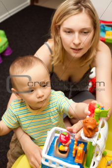 Baby And Mother Playing With The Toys