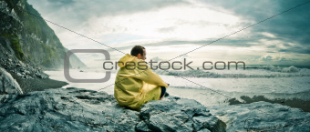 Man watching the ocean