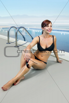 woman in black bathing suit on beach l