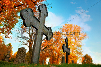 Metal cross on cemetery