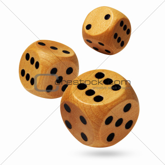 Three rolling wooden dices isolated on white