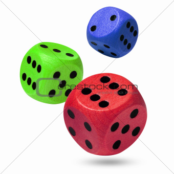 Red, green and blue wooden rolling dices on white