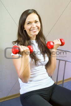 brunette girl makes physical exercise