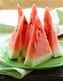 watermelon cut into slices on a plate - fruit dessert
