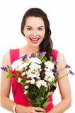 Surprised woman holding flowers