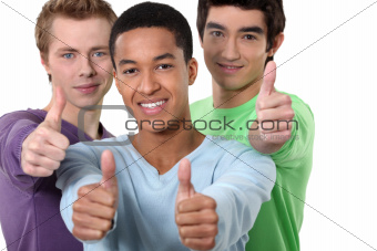 Three male friends giving thumbs-up
