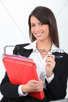 portrait of a businesswoman with file