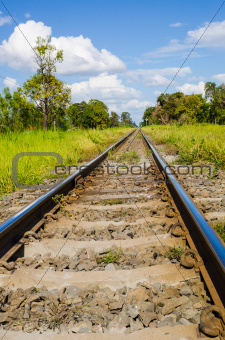 railway in green landscape