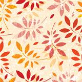 Seamless grunge pattern of colored leaves