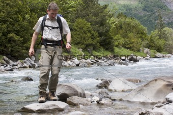Crossing a river in the mountains