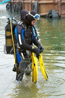scuba diver entering the water