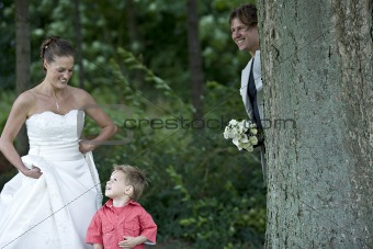 Groom playing hide and seek with his son