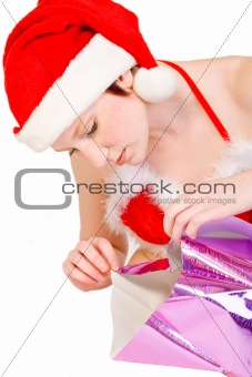 Christmas faerie unwrapping a present