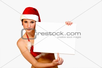 Christmas girl holding up a white sign for copyspace