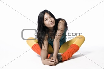 Asian model sitting and holding her feet