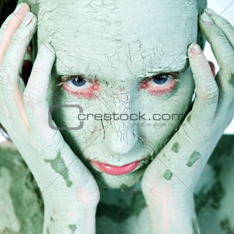 Hands on my green clay covered face