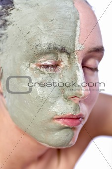 Relaxing with green clay on face
