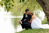 Newly Married Couple Kissing by Lake