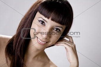 Young Woman Resting Her Head On Her Hand