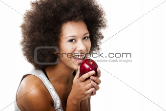 African American  young woman holding and eating an apple