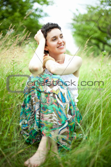 girl resting on fresh spring grass