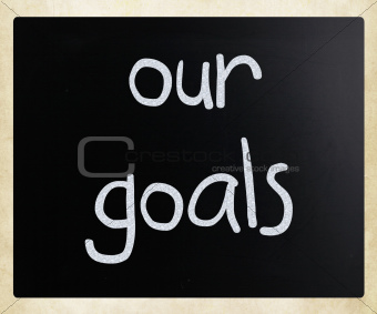"""Our goals"" handwritten with white chalk on a blackboard"