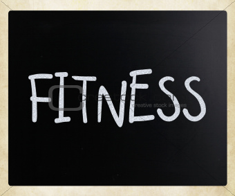 """Fitness"" handwritten with white chalk on a blackboard"