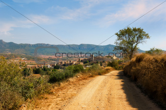 Montblanc in Spain.Landscape with rural road with fortness and mountains