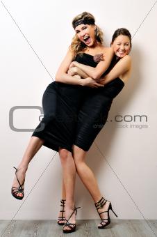 Two beautiful women having fun together.